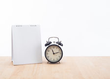 Blank calendar planner with clock and wood desk office Royalty Free Stock Photography