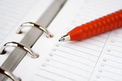 Blank calendar and red pen Royalty Free Stock Photos