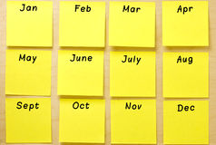 Blank Calendar Yellow Post-it Collection. Blank calendar of well-ordered square yellow post-it notes affixed on a wooden board. Each post-it is ready to take a Stock Photos