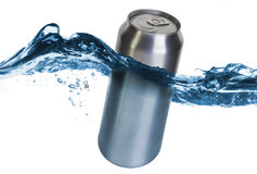 Blank can dropped into water stock photography