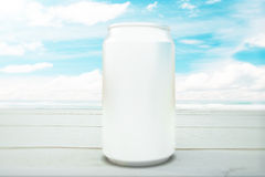 Blank can at seaside. Blank soda can on table at the seaside. Mock up, 3D Render Stock Photo