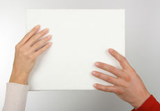 Blank canvas. Man's and female hand hold a canvas royalty free stock photo