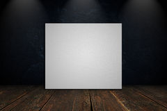 Blank canvas on a concrete wall. With wooden floor Stock Photo