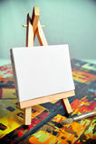Blank canvas on easel Stock Photos