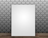 Blank canvas leaning against a wall with vintage pattern wallpap Stock Photos