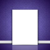 Blank canvas leaning on purple wallpaper. Blank canvas leaning against a wall with purple wallpaper Royalty Free Stock Photo