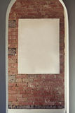 Blank canvas on rustic brick wall in archway Royalty Free Stock Photo