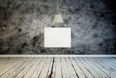 Blank canvas under a hanging lamp Stock Photography