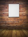 Blank canvas on wood wall Royalty Free Stock Images
