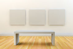 3 BLANK CANVASES HANGING ON A GALLERY WHITE WALL Stock Photography