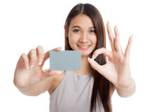 Blank card in beautiful young Asian woman hand  show OK sign Royalty Free Stock Image