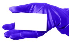 Blank Card & Blue Glove. Elegant blue-gloved hand holding a blank business card.  Isolated Stock Photo