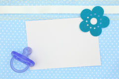 Blank card and blue pacifier Royalty Free Stock Photos