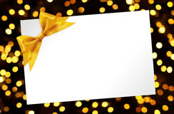 Blank Card with bow in golden lights background Royalty Free Stock Image