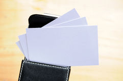 Blank card in box. Several blank business cards in a name card back over a wooden background Royalty Free Stock Images