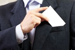 Blank card in businessmen hand Stock Images