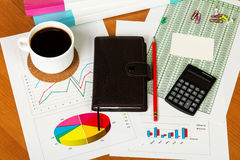 Blank card, calculator, coffee cup, notebook, office supplies on desktop. Royalty Free Stock Image