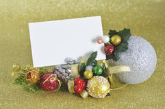 Blank card with christmas ornament on gold background Royalty Free Stock Photo