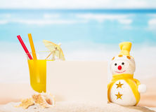 Blank card, cocktail, snowman, sea shells and  star in sand . Stock Photography