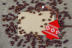 Blank card with coffee beans and Christmas decorations Stock Photography