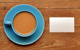 Blank card on coffee cup Stock Photo