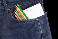 Blank card and color pencils at jeans Stock Images