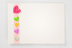 Blank card with colorful hearts over rose ribbon Stock Photo