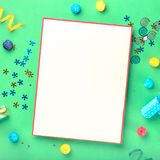 Blank card with different celebratory items on green background Stock Photos