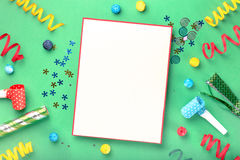 Blank card with different celebratory items on green background Stock Images