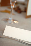 Blank card on dining table. Wedding table detail with empty space for name Royalty Free Stock Photo