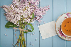 Blank card, english black tea and blooming lilac Royalty Free Stock Images