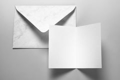 Blank card and envelope over grey background stock photo