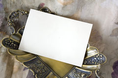 Blank card on golden tray Royalty Free Stock Photos