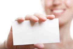 Blank card in hand Stock Image