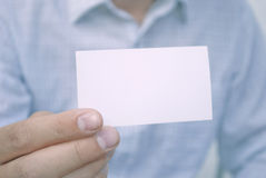 Blank card in hand. Closeup of blank card in man's hand Royalty Free Stock Photo