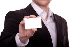 Blank card in a hand. Blank business card in a hand Royalty Free Stock Photography