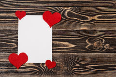 Blank card with heart on wooden background Royalty Free Stock Image