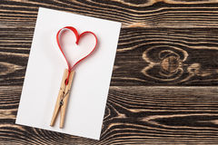 Blank card with heart on wooden background Royalty Free Stock Photo