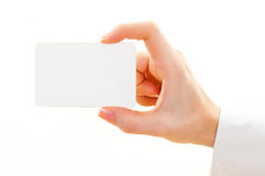 Blank card isolated on white. Female hand with a blank card isolated on white Stock Photo