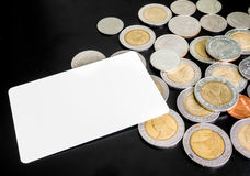 Blank card with lots of coins on black background Royalty Free Stock Photography