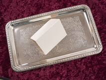 Blank card on ornate silver tray with red velvet Stock Images