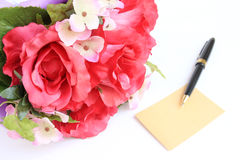 Blank card with pen and rose Stock Photo