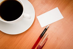 Blank card with pencil on coffee cup Royalty Free Stock Image