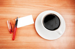 Blank card with pencil on coffee cup Royalty Free Stock Images