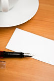 Blank card with pencil on coffee cup Stock Images
