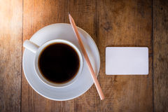 Blank card and pencil with coffee cup Stock Photo
