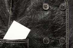 Blank card in a pocket of leather jacket Royalty Free Stock Photo