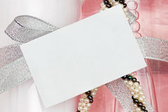 Blank card on pretty background. Blank white card for adding your own message on a pretty background Stock Photos