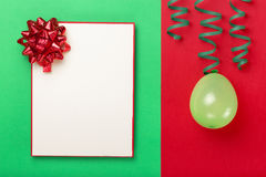 Blank card with red bow, balloon and streamer Royalty Free Stock Image
