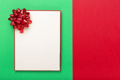 Blank card with red bow on colorful background Royalty Free Stock Images
